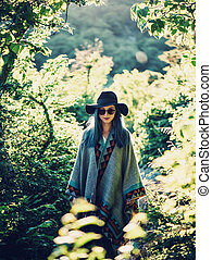 Boho style girl in the forest