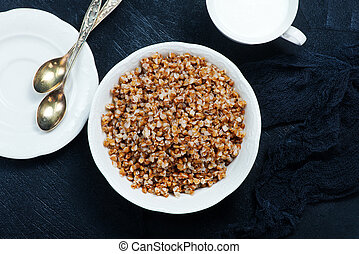 boiled buckwheat in bowl and on a table