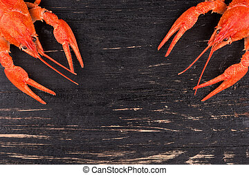 Boiled crawfish - Two red boiled crawfish in the corners on ...