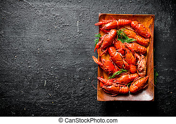 Boiled crayfish on a plate with dill.