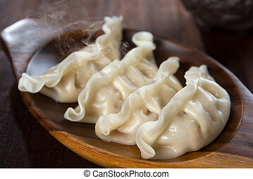 Boiled Dumplings - Close up fresh dumplings with hot steams ...