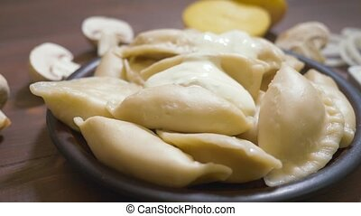 Boiled dumplings stuffed in a plate, Ukrainian national dish...