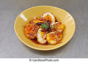 Boiled egg fried with tamarind sauce, Thai cuisine