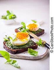 Boiled egg with pesto on toast