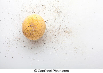 Boiled egg yolk on white background. Added salt and pepper