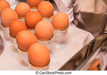 Boiled eggs in egg cups