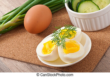 Boiled eggs on white plate