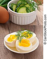 Boiled eggs on white plate