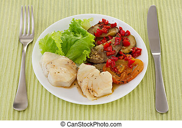 boiled fish in sauce with vegetables