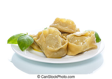 Boiled manti with meat on a plate