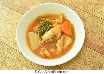 boiled mixed vegetable topping shrimp Thai spicy soup on bowl