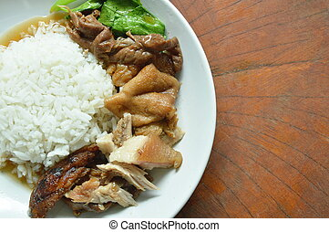 boiled pork leg in black Chinese herb soup slice with rice on plate