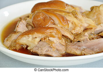 boiled pork leg with black Chinese herb soup slice on plate