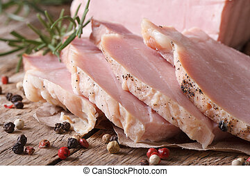 boiled pork with spices and rosemary close up, horizontal