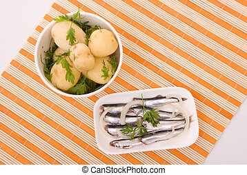 Boiled potatoes and salty fish