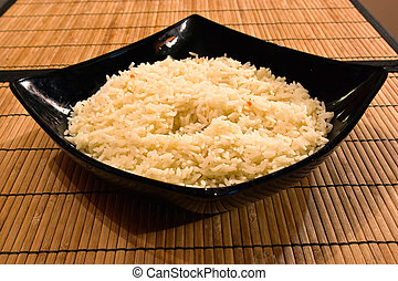 boiled rice in a deep black plate