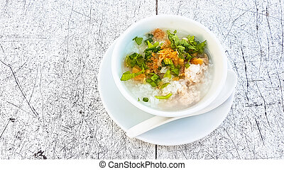 Boiled rice pork in white bowl on the table