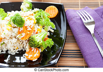 boiled rice with mix vegetables in black dish