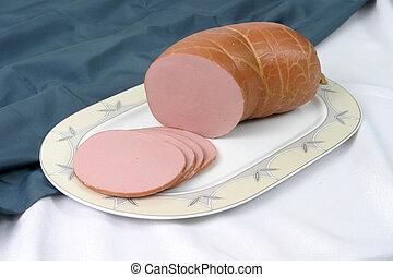 sausage - Boiled sausage on a plate
