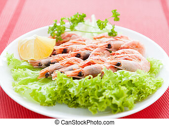 Boiled shrimp on a white plate