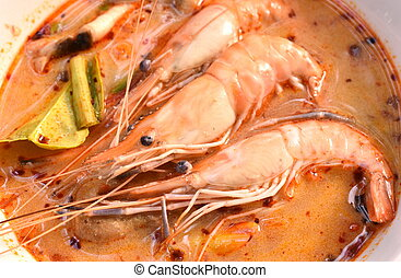 boiled shrimp with herb in Thai spicy soup or tom yum kung on bowl