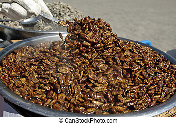 Boiled silkworm pupae (traditional street food in Korea)