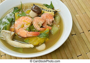 boiled spicy mixed vegetable with shrimp and smoked dry fish soup on bowl
