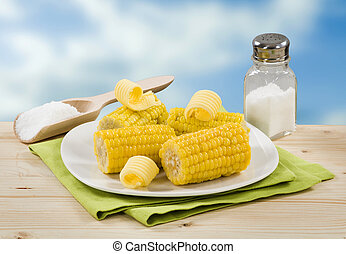 Boiled sweet corn with butter and salt