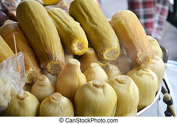 Boiled sweet corns sold on the street in Bangkok.