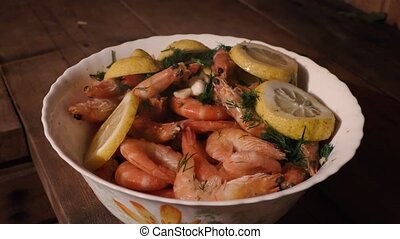 boiled tiger shrimps with dill garlic and lemon.