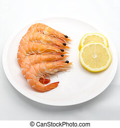 Boiled tiger shrimps with lemon slice