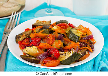 boiled vegetables on the white plate
