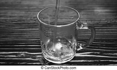 Boiled water in a glass cup.Full hd video - Boiled water in...