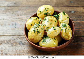 Boiled young potatoes in a plate