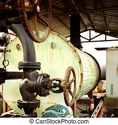 Boiler and valves - Place in a large industrial boilers...