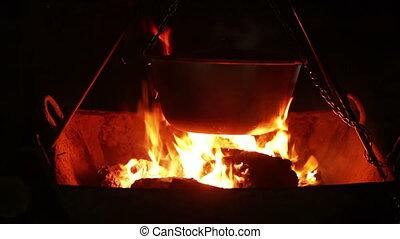 At night boiler over coals