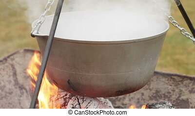 Pot for cooking over burning wood