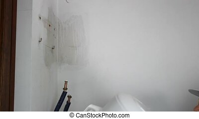 boiler - plumber installing an electric water heater