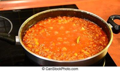 Boiling Bolognese sauce