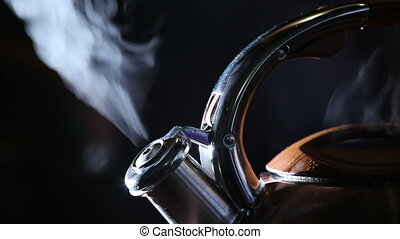 boiling kettle on a black background 7