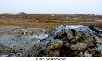 Boiling muddy bubbles in Gobustan near Baku - Boiling muddy...