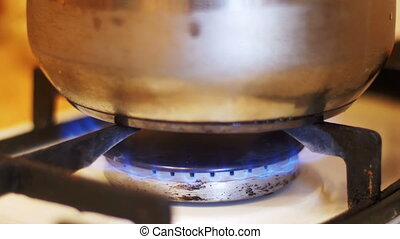Boiling Pot is on a Gas Stove. Cooking Food at Home