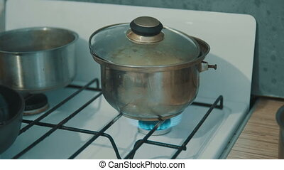 Boiling potatoes cooked in a saucepan on a stove