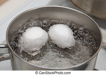 Boiling Two Eggs - Two eggs boiling in  pan of water