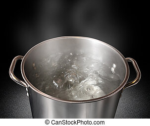 Boiling Water - Boiling water in a kitchen pot as a symbol...