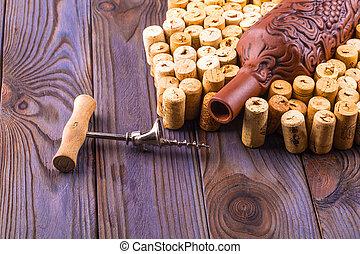 bois, métal, bouchon, argile, tire-bouchon, bouteille, table.