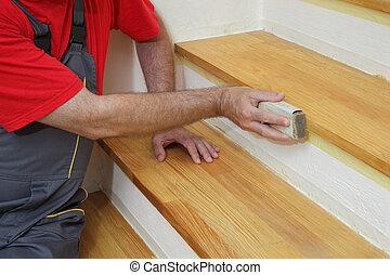 r novation bois calfatage silicone maison escalier photographie de stock rechercher. Black Bedroom Furniture Sets. Home Design Ideas