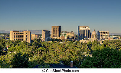 Boise Idaho City skyline with Americal Flag - Surrounded by...