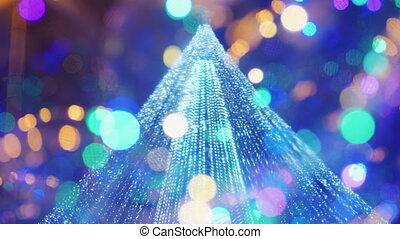 Bokeh and blurry lights of a Christmas tree. Christmas...