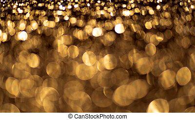 Golden glitter particles background. Sparkling light.